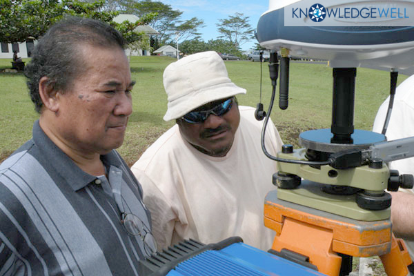 Kondios Gornelius PLS Pohnpei State Surveyor left oversees setup of RTK GPS System in Pohnpei Federated States of Micronesia