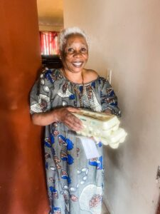RALEIGH: FarmingWell Welcomes Refugee Grandmother caring for 10 grandchildren from Congo with Local Eggs in recycled cartons